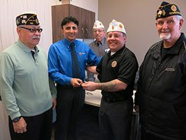 Dr. Singh shaking hands