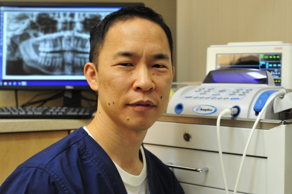Romeoville, IL oral surgeon Clarence Tang MD